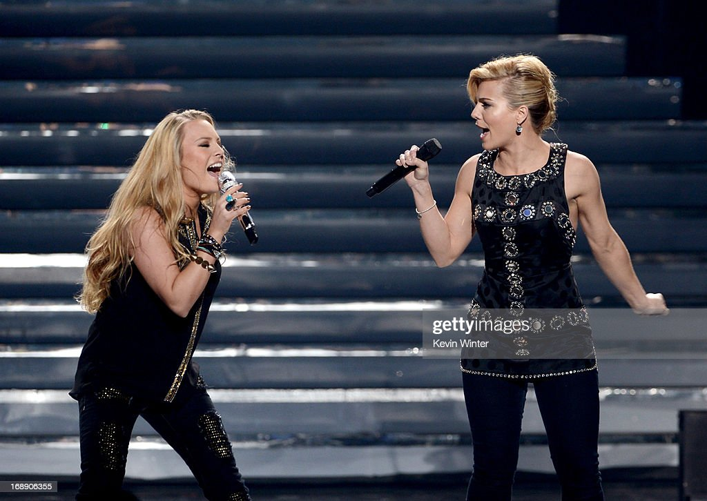 Singer Kimberly Perry of The Band Perry (R) and singer Janelle Arthur perform onstage during Fox's 'American Idol 2013' Finale Results Show at Nokia Theatre L.A. Live on May 16, 2013 in Los Angeles, California.