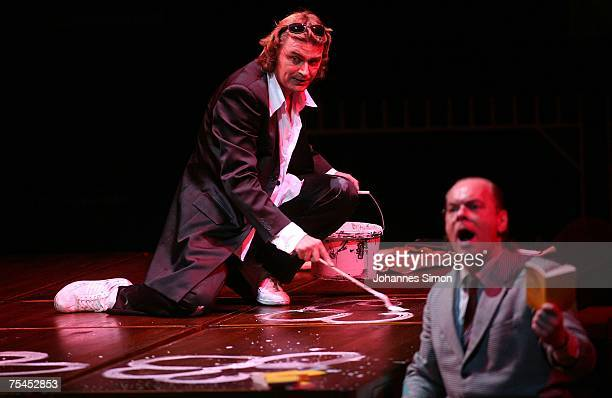 Singer Klaus Florian Vogt , playing the part of Walther von Stolzing and Michael Volle, playing the part of Sixtus Beckmesser perform on stage during...