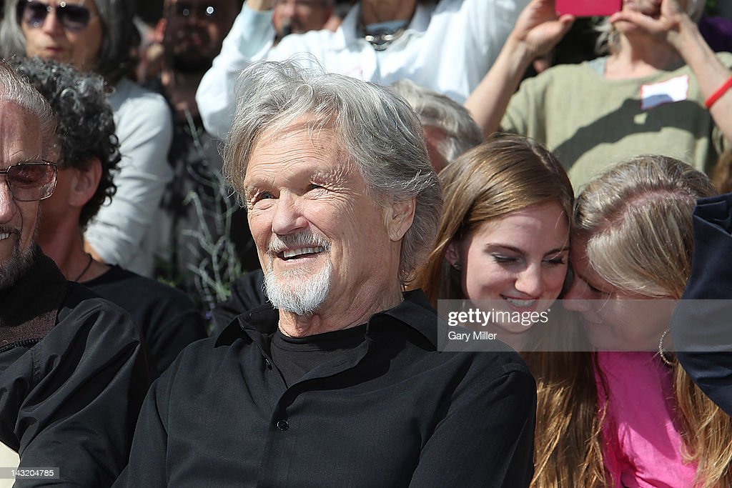 Singer Kris Kristofferson watches during the unveiling of Willie Nelson's statue at ACL Live on April 20, 2012 in Austin, Texas.
