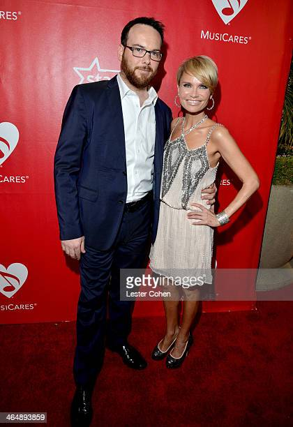 Singer Kristin Chenoweth and producer Dana Brunetti attend 2014 MusiCares Person Of The Year Honoring Carole King at Los Angeles Convention Center on...