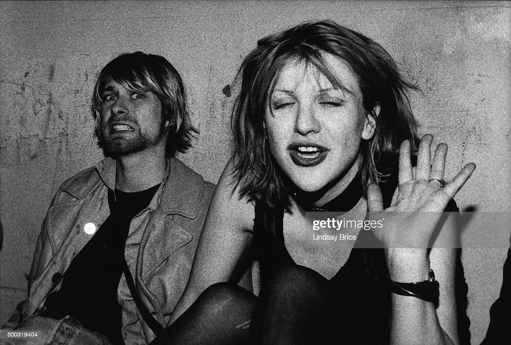 Singer Kurt Cobain (L) of the rock group Nirvana and Courtney Love of Hole on VIP balcony of The Hollywood Palladium for a Mudhoney concert on September 27, 1992 in Los Angeles, California.