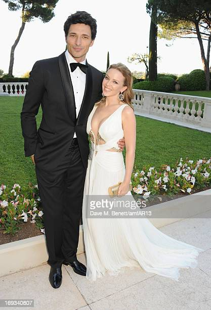Singer Kylie Minogue and Andres Velencoso attend amfAR's 20th Annual Cinema Against AIDS during The 66th Annual Cannes Film Festival at Hotel du...