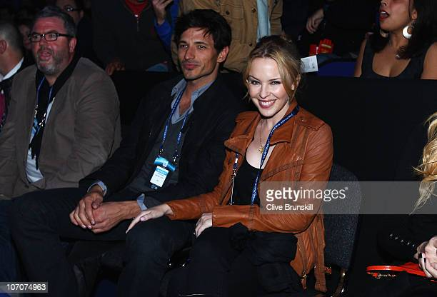 Singer Kylie Minogue and Andres Velencoso attend the singles match between Rafael Nadal of Spain and Andy Roddick of the United States during the...