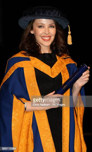 Singer Kylie Minogue holds her honorary degree from Anglia Ruskin University in Chelmsford Essex