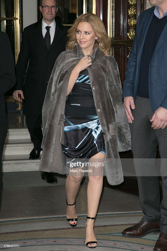 Singer Kylie Minogue leaves the 'MEURICE' hotel on March 19, 2014 in Paris, France.