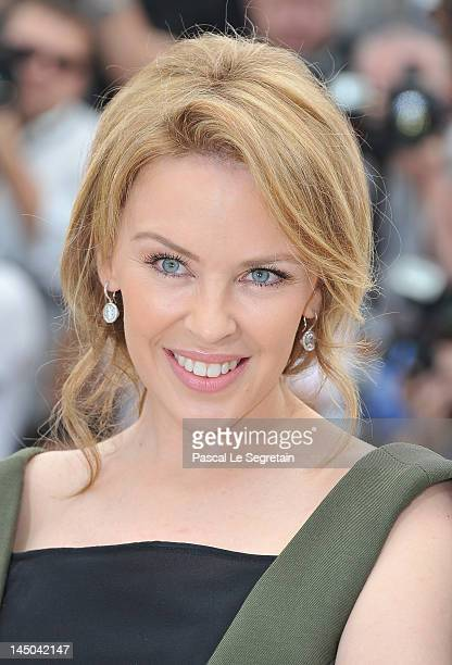 Singer Kylie Minogue poses at the Holy Motors Photocall during the 65th Annual Cannes Film Festival at Palais des Festivals on May 23 2012 in Cannes...