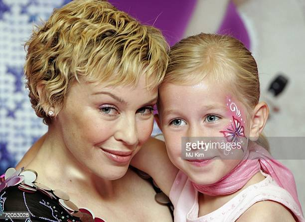 Singer Kylie Minogue with her fan Megan Hondius during a signing of her new book 'The Showgirl Princess' at Waterstone's Oxford Street on September...