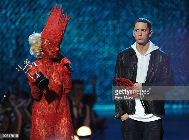 Singer Lady Gaga accepts an award onstage from rapper Eminem and actor Tracy Morgan during the 2009 MTV Video Music Awards at Radio City Music Hall...
