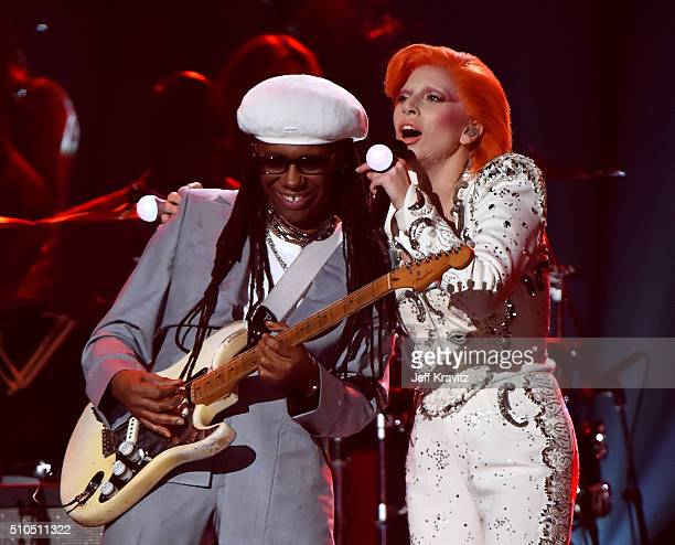 Singer Lady Gaga accompanied by musician/producer Nile Rodgers performs a tribute to the late David Bowie onstage during The 58th GRAMMY Awards at...