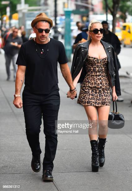 Singer Lady Gaga and Christian Carino are seen walking in SoHo on June 28 2018 in New York City