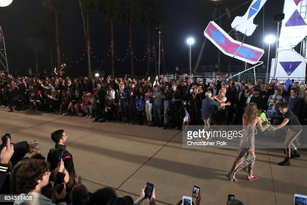 Singer Lady Gaga and fashion designer Tommy Hilfiger attend the TommyLand Tommy Hilfiger Spring 2017 Fashion Show on February 8 2017 in Venice...