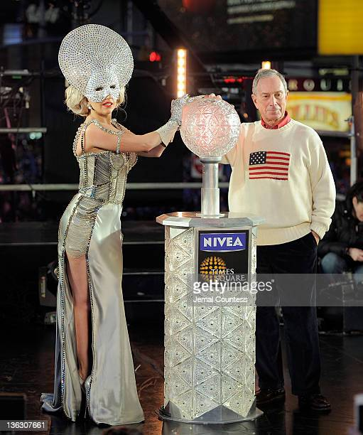 Singer Lady Gaga and New York Mayor Michael Bloomberg prepare to push the button to drop the ball at New Year's Eve 2012 in Times Square on December...