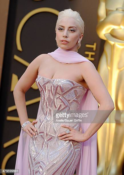 Singer Lady Gaga arrives at the 86th Annual Academy Awards at Hollywood Highland Center on March 2 2014 in Hollywood California