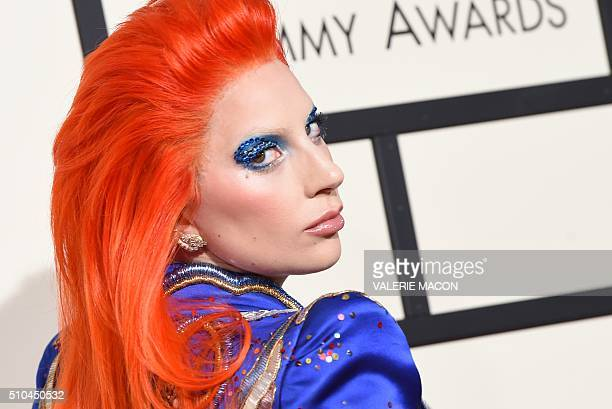 TOPSHOT Singer Lady Gaga arrives on the red carpet during the 58th Annual Grammy Music Awards in Los Angeles February 15 2016 AFP PHOTO/ Valerie...