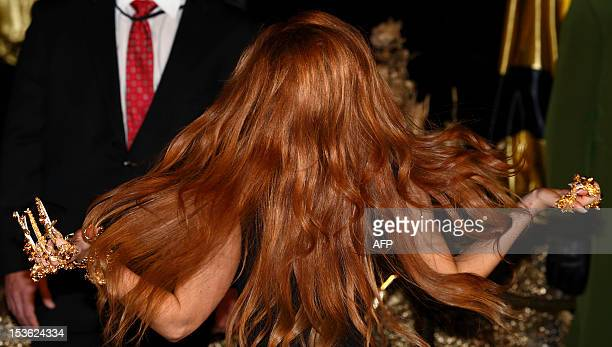 Singer Lady Gaga flicks her hair as she arrives at Harrods in Central London on October 7 to launch her first fragrance Lady Gaga Fame AFP...