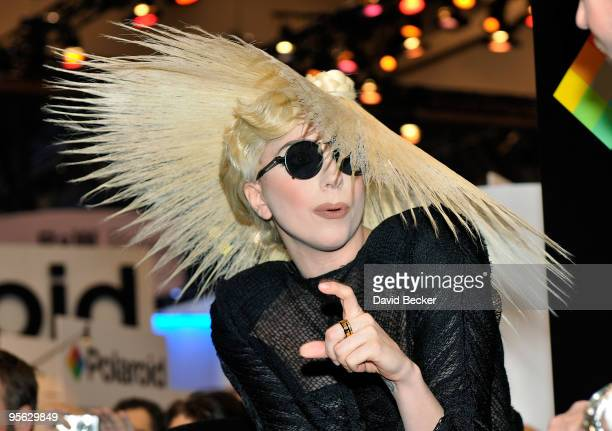 Singer Lady Gaga gestures during an announcement of her long term partnership with Polaroid as the brand's creative director on a specialty line of...