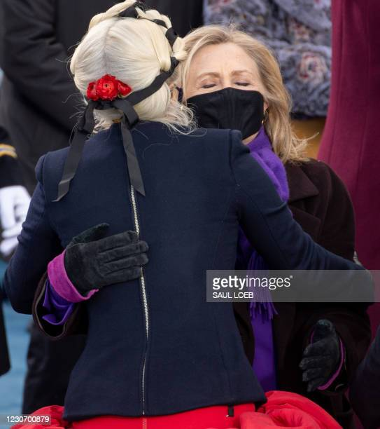 Singer Lady Gaga hugs US former Secretary of State Hillary Clinton before US President-elect Joe Biden is sworn in as the 46th US President on...