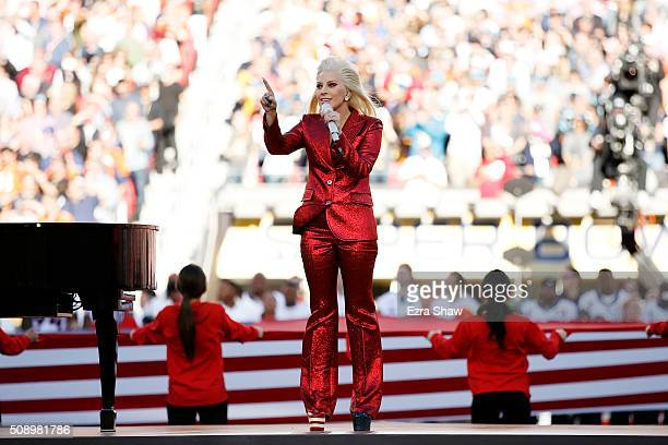 Singer Lady Gaga performs during Super Bowl 50 between the Denver Broncos and the Carolina Panthers at Levi's Stadium on February 7 2016 in Santa...
