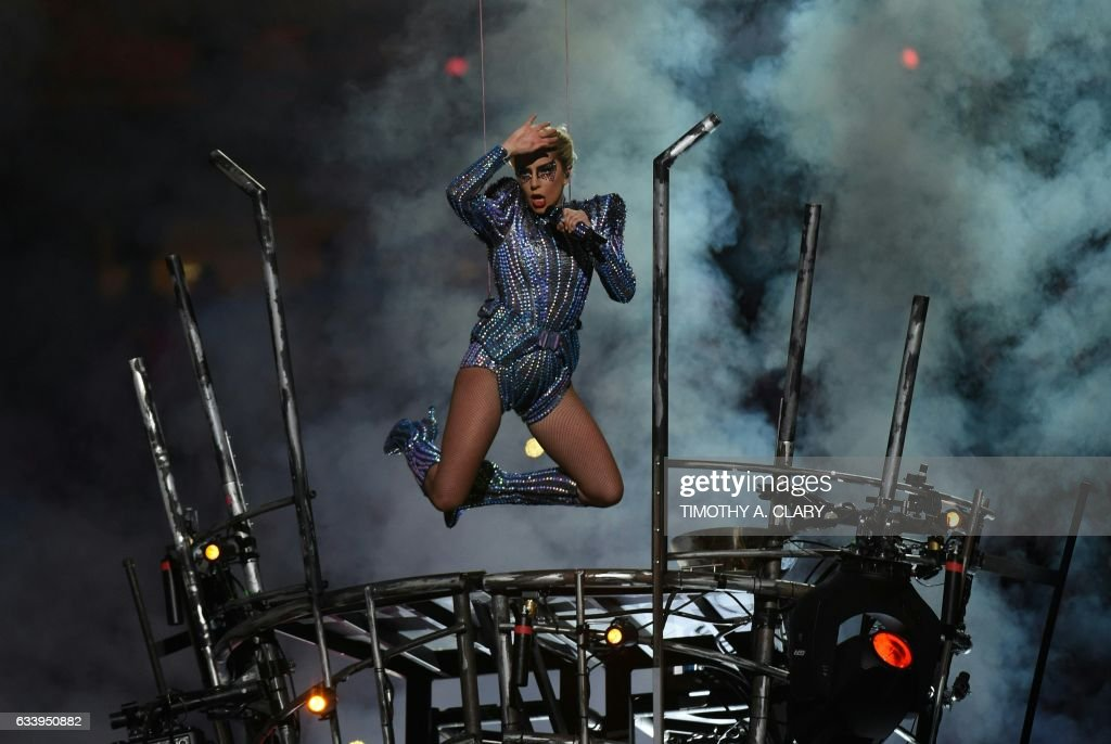 TOPSHOT - Singer Lady Gaga performs during the halftime show of Super Bowl LI at NGR Stadium in Houston, Texas, on February 5, 2017. / AFP PHOTO / Timothy A. CLARY
