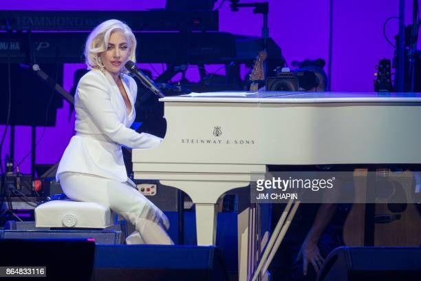 Singer Lady Gaga performs during the Hurricane Relief concert in College Station Texas on October 21 2017 Lady Gaga gave a surprise performance at...
