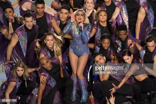 TOPSHOT Singer Lady Gaga performs during the Pepsi Super Bowl LI Halftime Show at Houston NRG Stadium in Houston Texas February 5 2017 / AFP PHOTO /...