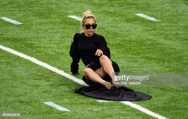 Singer Lady Gaga poses on the field at the Super Bowl LI before the start of the game at Houston NRG Stadium in Houston Texas on February 5 2017 /...
