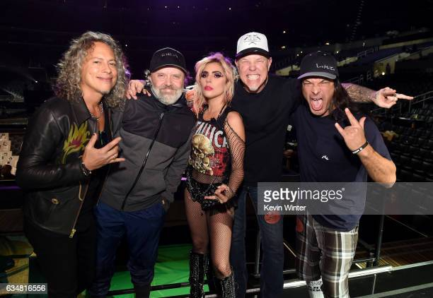 Singer Lady Gaga poses with musicians Kirk Hammett Lars Ulrich James Hetfield and Robert Trujillo onstage during the 59th GRAMMY Awards at STAPLES...