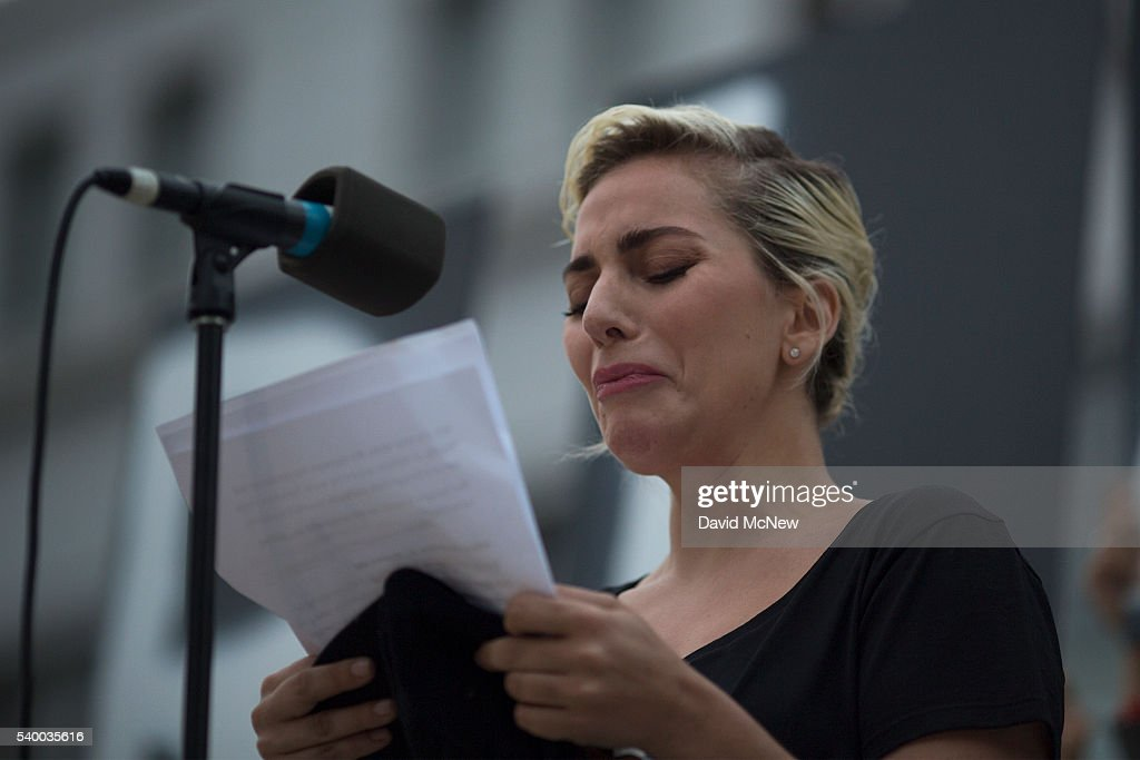 Singer Lady Gaga tries not to cry while reading some of the names of the dead at a vigil for the worst mass shooing in United States history on June 13, 2016 in Los Angeles, United States. A gunman killed 49 people and wounded 53 others at a gay nightclub in Orlando, Florida early yesterday morning before suspect Omar Mateen also died on-scene.