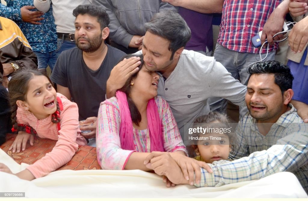 Singer Lakhwinder Wadali showing his grief with his cousins after the death of his uncle Ustad Pyarelal Wadali at his native village Guru Ki Wadali...