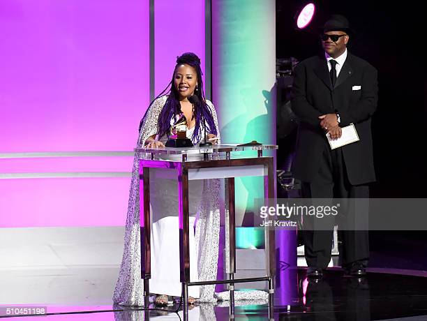 Singer Lalah Hathaway accepts the award for Best Traditional RB Performance for 'Litlle Ghetto Boy' alongside record producer Jimmy Jam onstage...