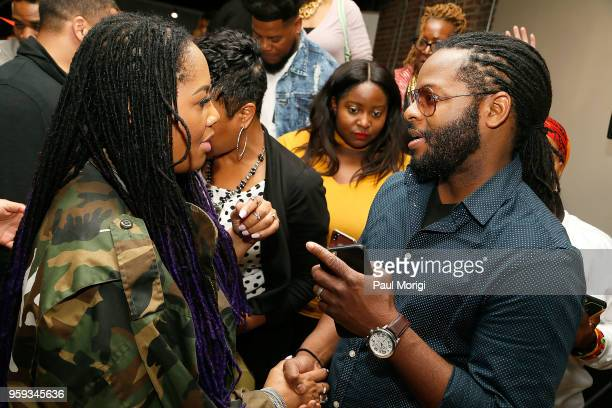 Singer Lalah Hathaway talks with a guest at the Vocal Health Clinic event hosted by The Recording Academy WDC Chapter and MusiCares at the National...