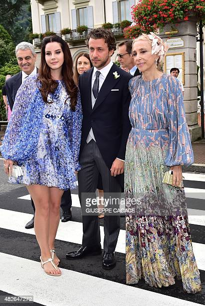 Singer Lana Del Rey, her partner Francesco Carrozzini and Italian journalist Franca Sozzani leave the Hotel Des Iles Borromees for the religious...