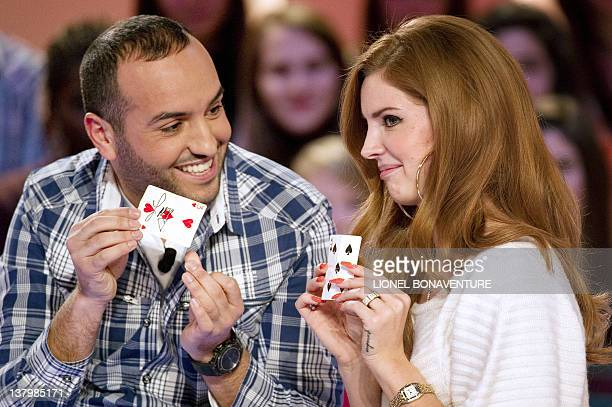 US Singer Lana del Rey takes part in a card trick with French magician Kamel during the TV broadcast show Le Grand Journal on Canal Plus channel set...