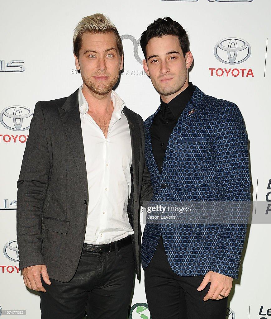 Singer Lance Bass and actor Michael Turchin attend the 2014 Environmental Media Awards at Warner Bros. Studios on October 18, 2014 in Burbank, California.