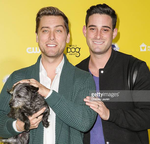 Singer Lance Bass and husband actor Michael Turchin arrive with their dog Lily at The World Dog Awards at Barker Hangar on January 10 2015 in Santa...
