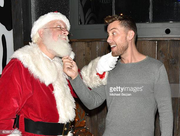 Singer Lance Bass and Santa at Not For Sale x Z Shoes Benefit at Estrella Sunset on December 9, 2016 in West Hollywood, California.