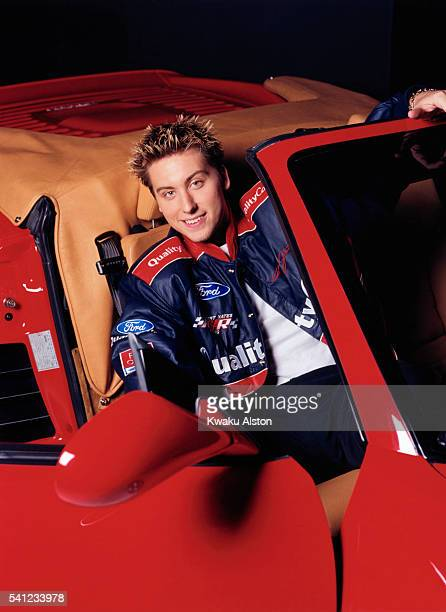Singer Lance Bass of 'N Sync is photographed in a sports car for YM Magazine in 2000 in Los Angeles California
