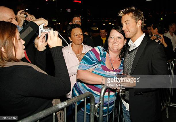 Singer Lance Bass poses for a photo with Stephanie Vega of Arizona during a celebration of the 2008 Georges Duboeuf Beaujolais Nouveau wine at the...
