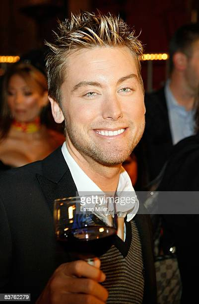 Singer Lance Bass poses with a glass of 2008 Georges Duboeuf Beaujolais Nouveau wine at the Paris Las Vegas early November 20 2008 in Las Vegas...