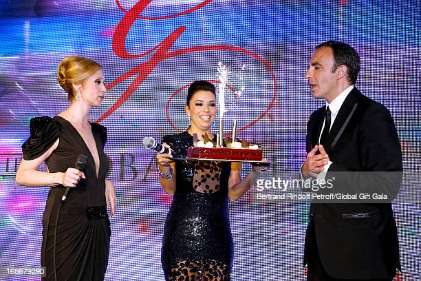 Singer Lara Fabian and Eva Longoria give a Birthday Cake to Nikos Aliagas which has 44 years old today 'Global Gift Gala' at Hotel George V on May 13...
