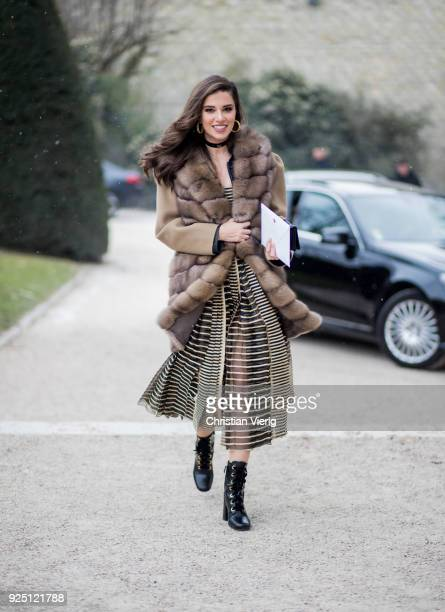 Singer Lara Scandar wearing dress and fur jacket is seen outside Dior on February 27 2018 in Paris France