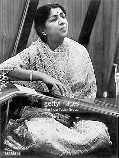 Singer Lata Mangeshkar performing at a function