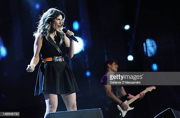 Singer Laura Pausini and Paolo Carta perform live during 2012 Wind Music Awards held at Arena of Verona on May 26, 2012 in Verona, Italy.