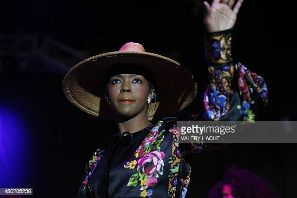 US singer Lauryn Hill acknowledges applausw on stage during the Nice's Jazz Festival on July 9 2015 in Nice southeastern France AFP PHOTO / VALERY...
