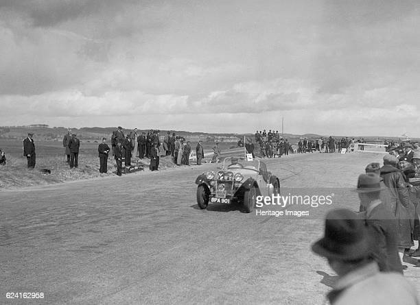 Singer Le Mans of FA Thatcher competing in the RSAC Scottish Rally 1934 Artist Bill BrunellSinger Le Mans 1933 972 cc Vehicle Reg No BPA901 Event...
