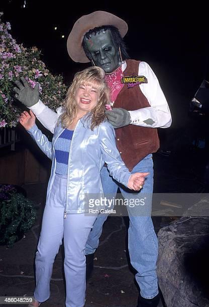 Singer LeAnn Rimes and Frankenstein at LeAnn Rimes' concert performance on April 16 1997 at Jurassic Park Plaza Universal Studios in Universal City...