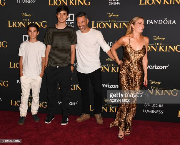 US singer LeAnn Rimes her husband actor Eddie Cibrian and his sons Mason and Jake arrive for the world premiere of Disney's The Lion King at the...