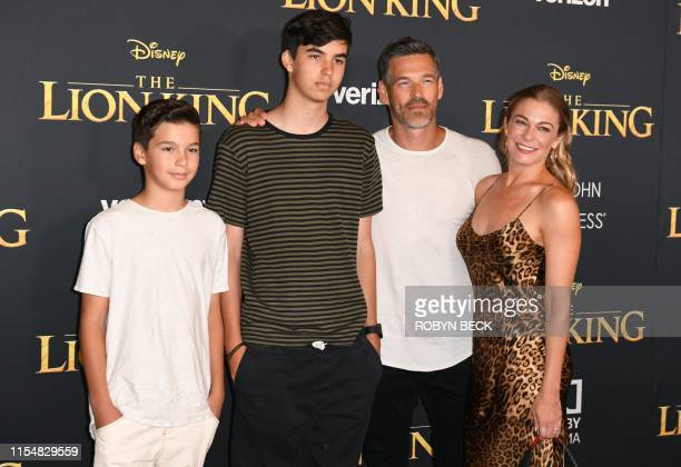 "Singer LeAnn Rimes, her husband actor Eddie Cibrian and his sons Mason and Jake arrive for the world premiere of Disney's ""The Lion King"" at the..."