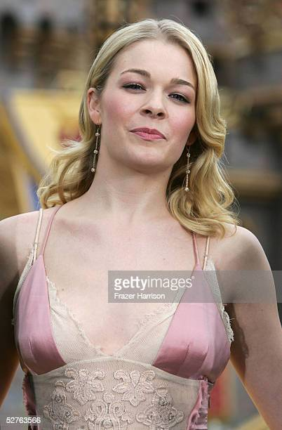 Singer Leann Rimes poses in front of the Sleeping Beauty Castle after launching the Happist Celebration on Earth during the Disneyland 50th...