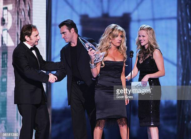 Singer Lee Ann Womack accepts the award for Single Of The Year from actors Joaquin Phoenix and Reese Witherspoon at the 39th Annual Country Music...